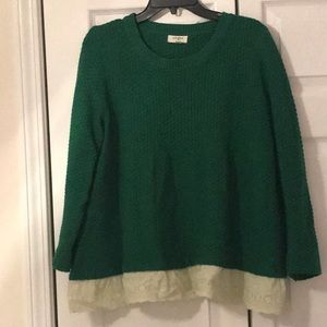 Green sweat with cream lace bottom accent.